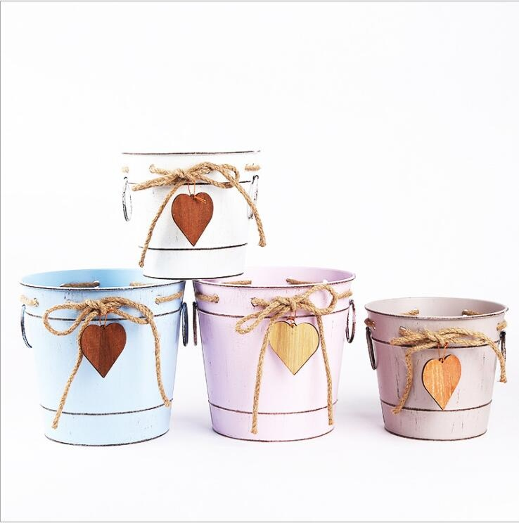 metal iron flower bucket with rope wooden heart design